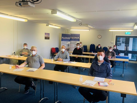 Delegates socially distance during the theory section of their course at Ridgway